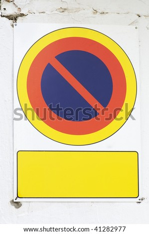 no parking sign in a white wall - stock photo