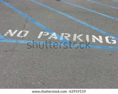 no parking sign on parking lot pavement