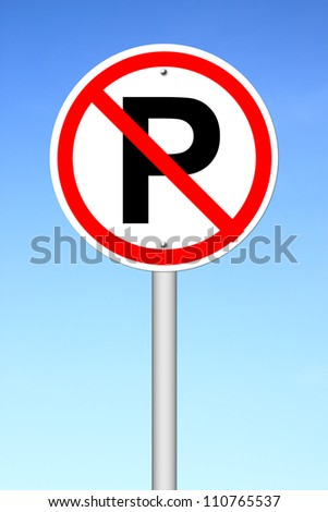 No parking sign over a blue sky - stock photo