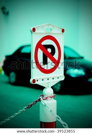 stock-photo-no-parking-sign-with-car-on-background-39523855.jpg