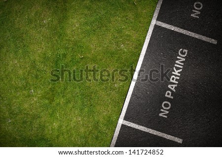No Parking Spots - Top View. Pavement and Grassy Field.
