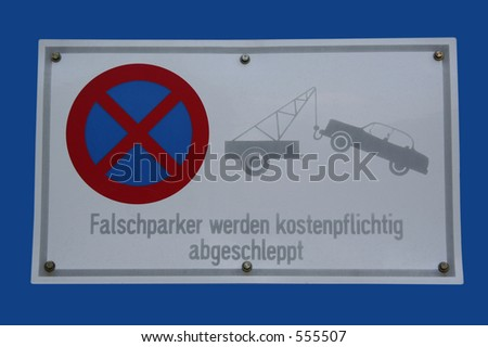 No Parking - Text in English: Cars parking here will be tow away - stock photo