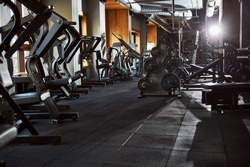 No people photo of an empty gym well-equipped with all kinds of machines