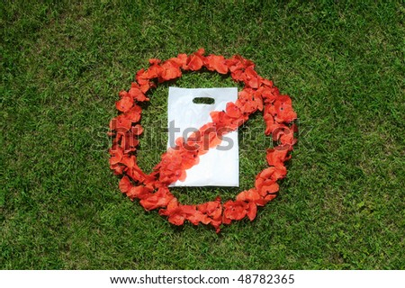 No plastic bag sign on grass with petals