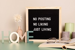 No posting, no liking, just living motivational quote on the letter board. Inspiration text for digital detox in the interior