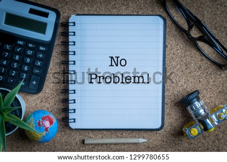 NO PROBLEM inscription written on book with globe,eyeglasses, calculator, camera, pencil and vase on wooden background with selective focus and crop fragment. Business and education concept Stock fotó ©