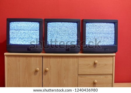 No signal just noise on three old TV screens