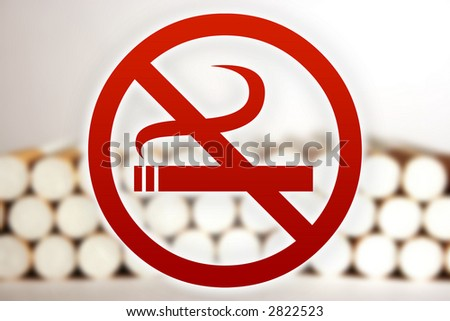 No smoking sign in front of blurry cigarettes.