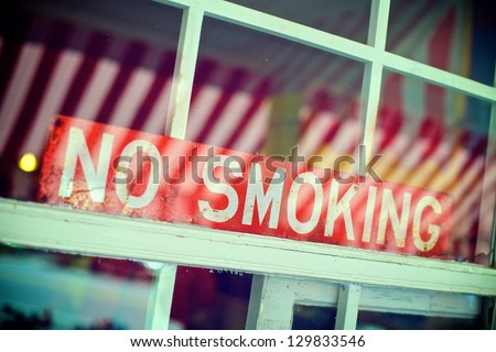 No Smoking Sign in the Window of a Restaurant