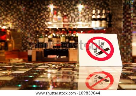 NO SMOKING sign on the bar.