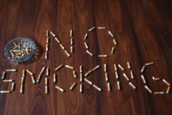 No smoking written with used cigarettes