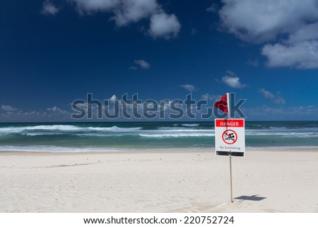 Stock Photo No swimming flag on the beach after storm
