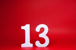 No. 13 ( thirteen ) Isolated red  Background with Copy Space - Lucky or unlucky Number 13% Percentage or Promotion - Discount or anniversary concept