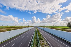 No traffic on this empty deserted modern deepened highway A4, The Hague - Rotterdam, Netherlands. This modern highway is built in a deepened location to save the Midden-Delfland nature reserve.