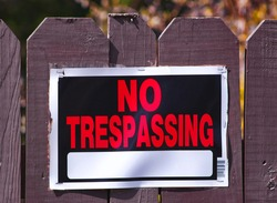 No Trespassing Sign on a Wooden Fence