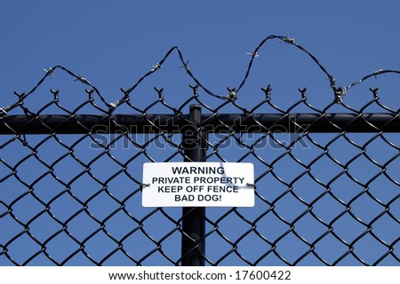 No Trespassing Sign on Chain Link Fence Horizontal