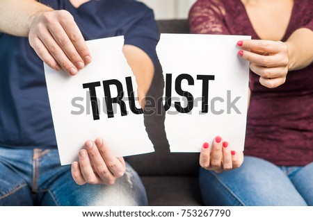 No trust. Cheating, infidelity, marital problems, having an affair and another partner, betrayal, mistrust or being unfaithful concept. Couple, man and woman, ripping same paper. #753267790