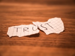 No trust handwritten teared up peace of paper on a table after cheating