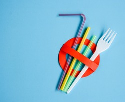 No use symbol in red with plastic straws and fork.  Plastic pollution is harmful to  marine lives. Environmental concept. Ban single use plastic campaign.