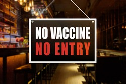 No Vaccine No Entry Sign at a bar, tavern or pub. Proof or vaccination required to enter a shop or business establishment.