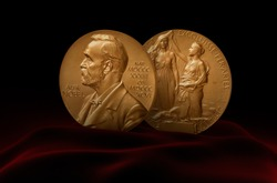 Nobel Prize Medal standing on a platform. Red and black background.