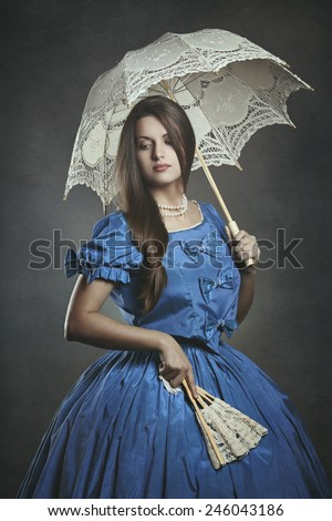 Noble beautiful woman posing with umbrella and fan  . Venice carnival