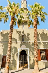 Noble entrance, noble gate of mosque with palms in City of Cape Town, South Africa.