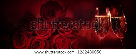 Noble red roses with sparkling champagne for valentine day