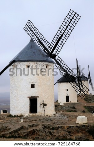 Nobody but the famous heritage of windmills on the hilltop of Consumers, Toledo, Spain. Jan. 18, 2015 #725164768