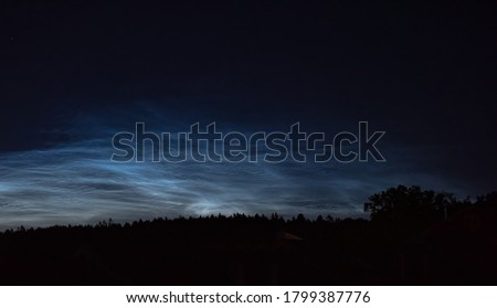 Noctilucent clouds high in the sky at midnight ストックフォト ©