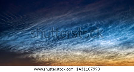 Noctilucent clouds, June 21, 2019 over Rhineland Germany, night shining ice clouds glow in a dark sky after sunset, the highest clouds in the Earth's mesosphere, a beautiful atmospheric phenomenon #1431107993