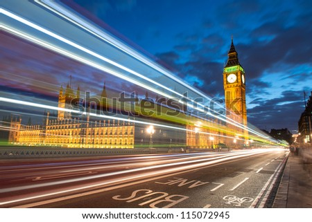 Nocturne scene with Big Ben and House of Parliament behind light beams - London - UK