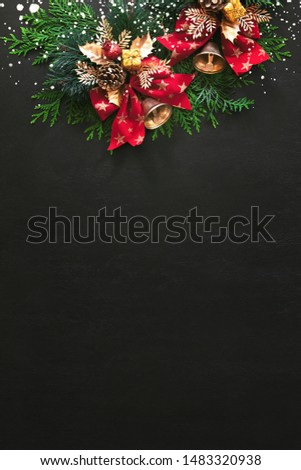 "Noel or Christmas greeting card concept with copy space for greetings or advertising text, view from above on traditional X-mass decorations lying down moody dark surface decorated with ""snow"" #1483320938"