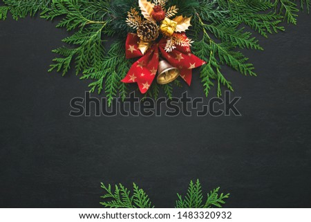 Noel or Christmas greeting card template with copy space for greetings or advertising text, view from above on traditional X-mas decorations lying down moody dark surface #1483320932