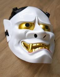Noh Theatre - A Japan traditional  white demon mask, Hanya on wood floor