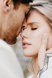 noise effect, selective focus: Emotional meeting, hugs and kisses on brides during wedding photography. Stylish couple of husband and wife