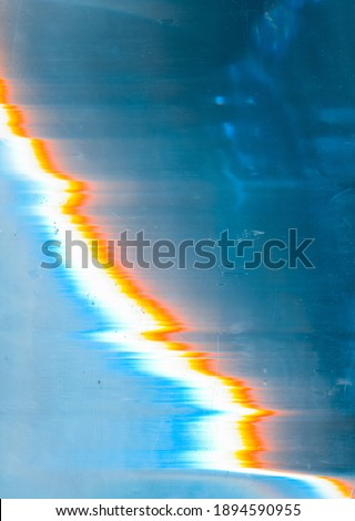 Noise overlay. Dust scratches filter. Blue damaged screen with colorful static digital glitch distortion stains artifacts defect. Distressed glass background. Foto stock ©