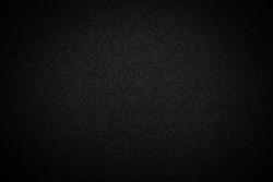 Noisy black background. Minimalist black paper backdrop.  Black metal background