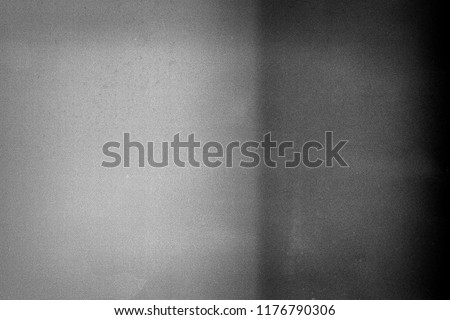 Noisy film frame with heavy noise, dust and grain. Abstract old film background