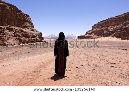 Nomadic woman with burka in wadi rum
