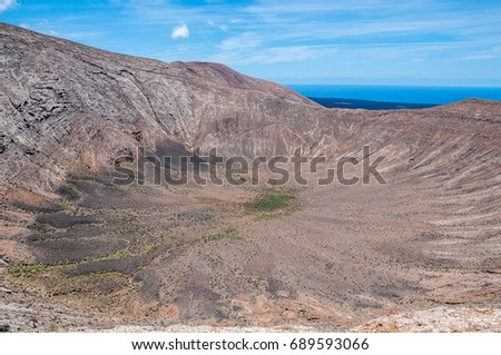 Non - active volcanic crater, Lanzarote, Canary Islands #689593066