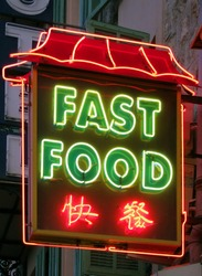 non-brand oriental fast food neon sign at dusk