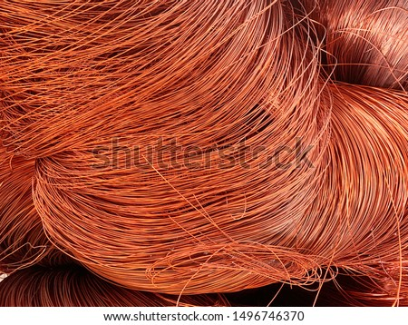 Non-ferrous copper metal is the recycle raw material for reproducing in industries. Recycling copper wire scrap from used motors for smelting manufactures. Metallic background.
