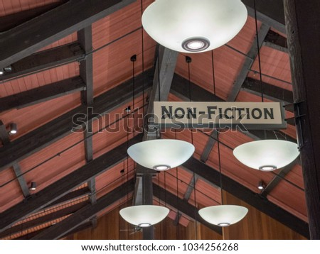 Non-fiction sign overhanging cabin library