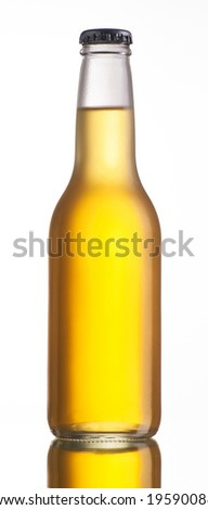 Non-glossy white beer bottle,back lighted showing a glowing golden beer content