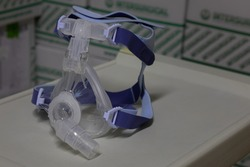 Non-invasive full-face ventilation mask (NIV mask) for non-invasive ventilation therapy is placed on a instrument table. This medical equipment is used for treat respiratory disorders, viral pneumonia
