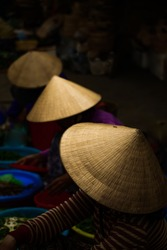 Non La, Top view lady wear vietnam hat at fresh market in morning, Hoi An ancient city of Vietnam
