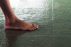 Non-slip floor tiles of the swimming pool with feet clipping path