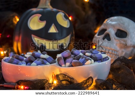 Non-traditional purple candy corn in a dimly lit spooky Halloween theme