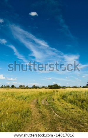 Non urban scene with country road and clouds